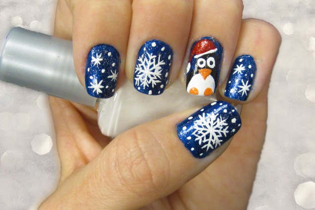 nail-art-creative-christmas-themed-snow-and-pinguin-print-nail-art-design-with-cool-blue-glitter-cool-easy-nail-design-ideas-634x422
